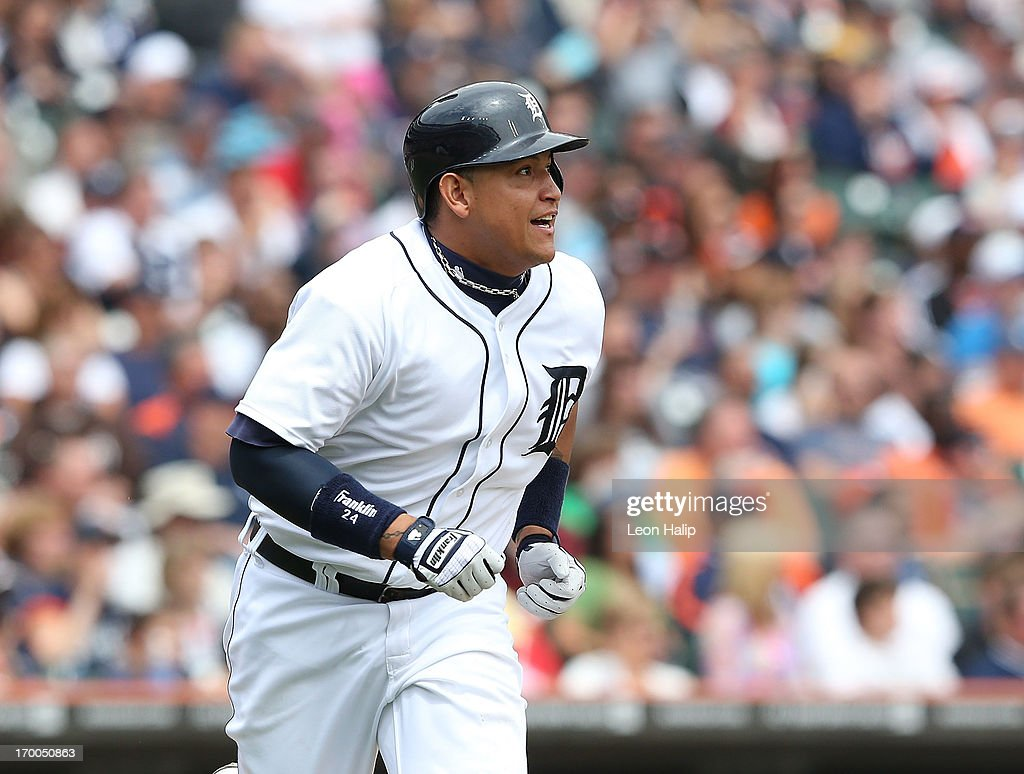<a gi-track='captionPersonalityLinkClicked' href=/galleries/search?phrase=Miguel+Cabrera&family=editorial&specificpeople=202141 ng-click='$event.stopPropagation()'>Miguel Cabrera</a> #24 of the Detroit Tigers singles to center field scoring Don Kelly #32 in the fifth inning of the game against the Tampa Bay Rays at Comerica Park on June 6, 2013 in Detroit, Michigan. The Tigers defeated the Rays 5-2.