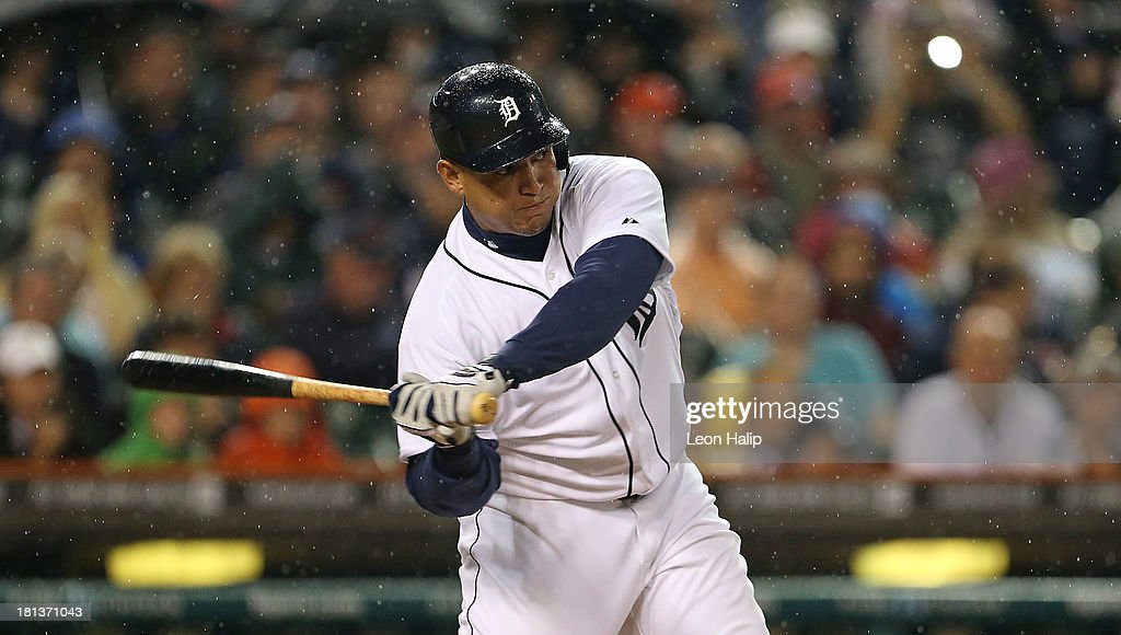 Miguel Cabrera #24 of the Detroit Tigers singles to left field, scoring Ramon Santiago during the third inning of the game against the Chicago White Sox at Comerica Park on September 20, 2013 in Detroit, Michigan.