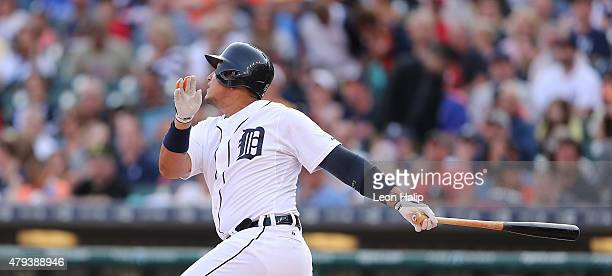 Miguel Cabrera of the Detroit Tigers singles to right field in the first inning of the game against the Toronto Blue Jays scoring Yoenis Cespedes on...