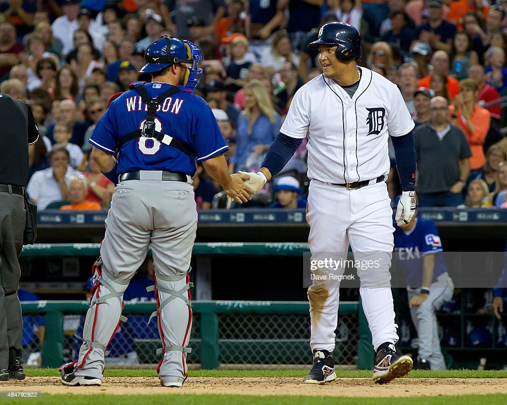 Miguel Cabrera 24 Of The Detroit Tigers Slaps Hands With Bobby Wilson 8
