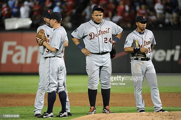 Miguel Cabrera of the Detroit Tigers stands during a pitcher change with Brandon Inge Jhonny Peralta and Ramon Santiago in the third inning of Game...
