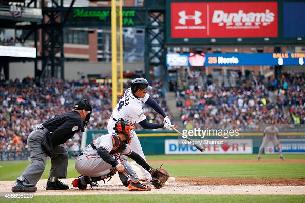 Miguel Cabrera of the Detroit Tigers strikes out in the first inning against the Baltimore Orioles during Game Three of the American League Division...