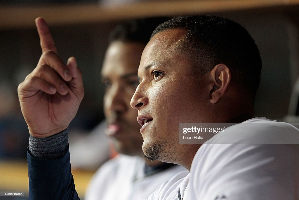 <a gi-track='captionPersonalityLinkClicked' href=/galleries/search?phrase=Miguel+Cabrera&family=editorial&specificpeople=202141 ng-click='$event.stopPropagation()'>Miguel Cabrera</a> #24 of the Detroit Tigers talks with a teammate after hitting a solo home run to center field in the eighth inning during the game against the New York Yankees at Comerica Park on June 2, 2012 in Detroit, Michigan. The Tigers defeated the Yankees 4-3.