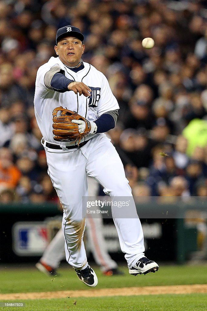 Miguel Cabrera #24 of the Detroit Tigers throws out Gregor Blanco #7 of the San Francisco Giants who hit a grounder to third base in the seventh inning during Game Three of the Major League Baseball World Series at Comerica Park on October 27, 2012 in Detroit, Michigan.