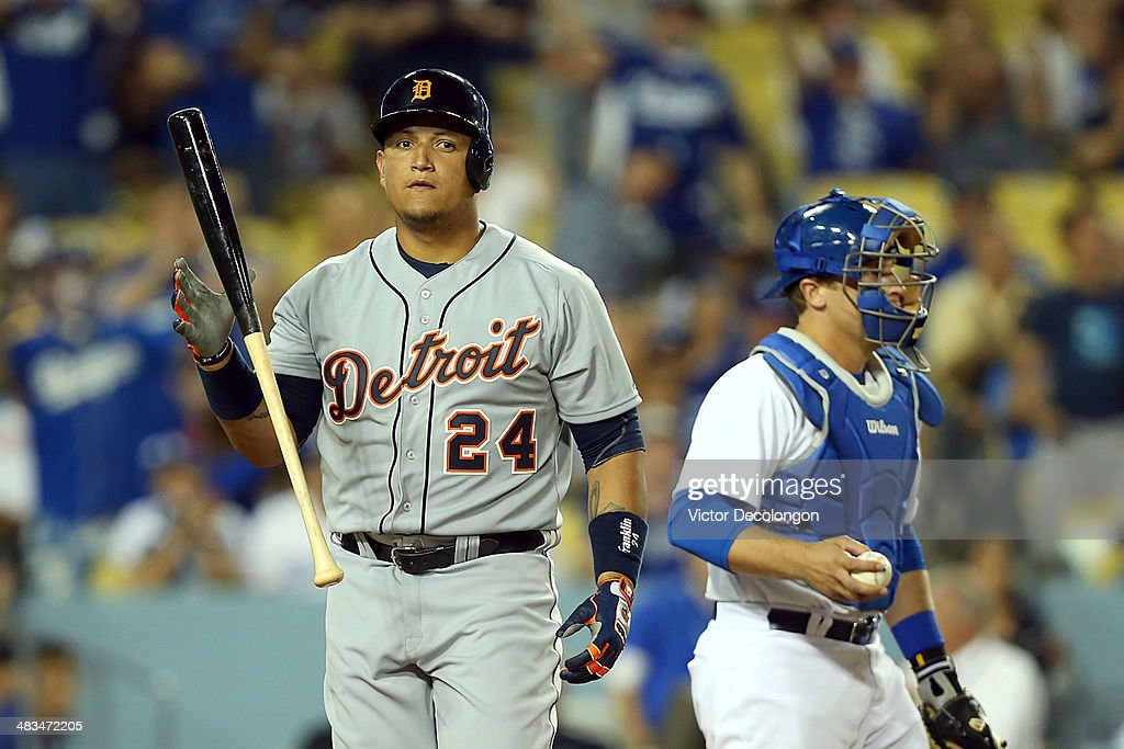 <a gi-track='captionPersonalityLinkClicked' href=/galleries/search?phrase=Miguel+Cabrera&family=editorial&specificpeople=202141 ng-click='$event.stopPropagation()'>Miguel Cabrera</a> #24 of the Detroit Tigers tosses his bat after striking out in the ninth inning for the second out as catcher Tim Federowicz #26 of the Los Angeles Dodgers looks on during the MLB game at Dodger Stadium on April 8, 2014 in Los Angeles, California. Figgins scored the eventual game-winning run. The Dodgers defeated the Tigers 3-2 in 10 innings.