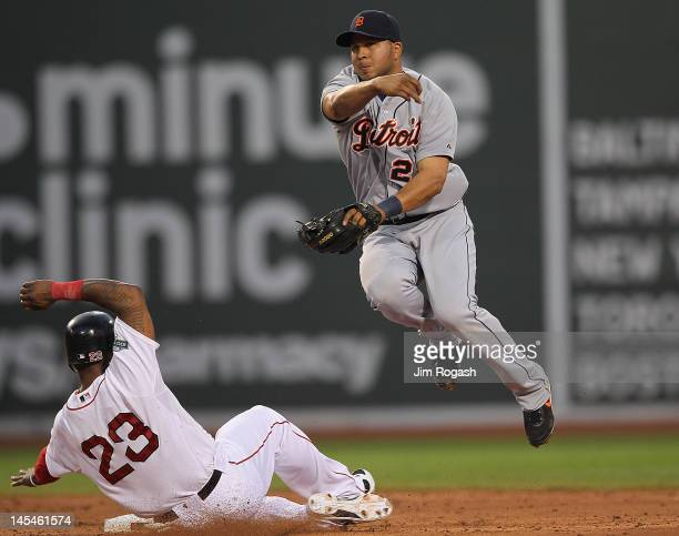 Miguel Cabrera of the Detroit Tigers turns a double play as Marlon Byrd of the Boston Red Sox slides in the third inning at Fenway Park May 30 2012...