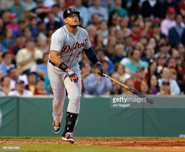 Miguel Cabrera of the Detroit Tigers watches the flight of his home run against the Boston Red Sox in the third inning at Fenway Park on May 17 2014...