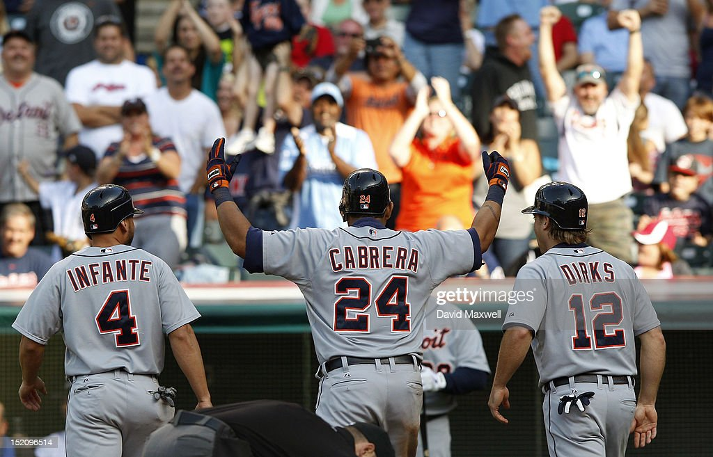 <a gi-track='captionPersonalityLinkClicked' href=/galleries/search?phrase=Miguel+Cabrera&family=editorial&specificpeople=202141 ng-click='$event.stopPropagation()'>Miguel Cabrera</a> #24 of the Detroit Tigers waves to fans as he heads to the dugout with <a gi-track='captionPersonalityLinkClicked' href=/galleries/search?phrase=Omar+Infante&family=editorial&specificpeople=203255 ng-click='$event.stopPropagation()'>Omar Infante</a> #4 and <a gi-track='captionPersonalityLinkClicked' href=/galleries/search?phrase=Andy+Dirks&family=editorial&specificpeople=7511216 ng-click='$event.stopPropagation()'>Andy Dirks</a> #12 after hitting a three run home run against the Cleveland Indians during the seventh inning of their game on September 16, 2012 at Progressive Field in Cleveland, Ohio.