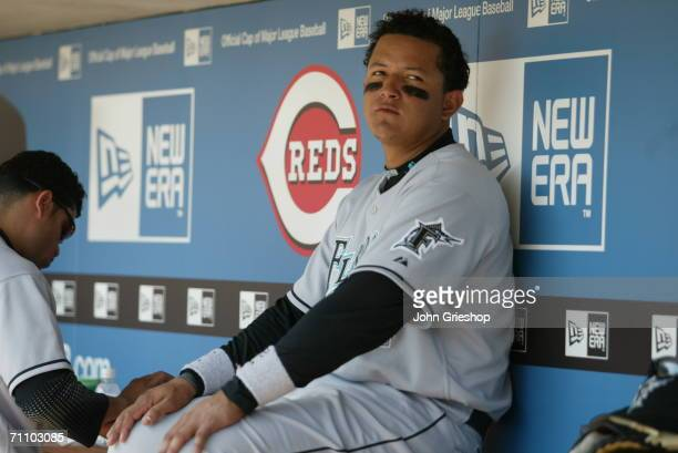 Miguel Cabrera of the Florida Marlins leans against a New Era logo in the dugout during the game against the Cincinnati Reds at Great American Ball...