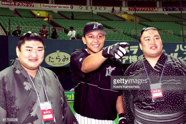 Miguel Cabrera of the Florida Marlins poses with Kotomituki sumo wrestlers during the 4th game of the exhibition series between US MLB and Japanese...