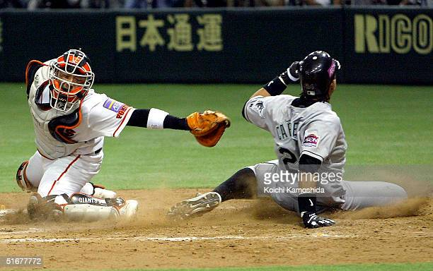 Miguel Cabrera of the Florida Marlins slides into home base during the 1st game of the exhibition series between US MLB and Japanese Professional...