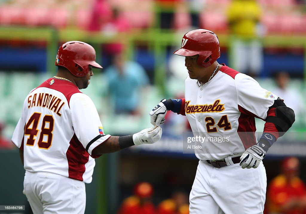 <a gi-track='captionPersonalityLinkClicked' href=/galleries/search?phrase=Miguel+Cabrera&family=editorial&specificpeople=202141 ng-click='$event.stopPropagation()'>Miguel Cabrera</a> #24 of Venezuela celebrates with <a gi-track='captionPersonalityLinkClicked' href=/galleries/search?phrase=Pablo+Sandoval&family=editorial&specificpeople=803207 ng-click='$event.stopPropagation()'>Pablo Sandoval</a> #48 after hitting a home run against Spain during the first round of the World Baseball Classic at Hiram Bithorn Stadium on March 10, 2013 in San Juan, Puerto Rico.