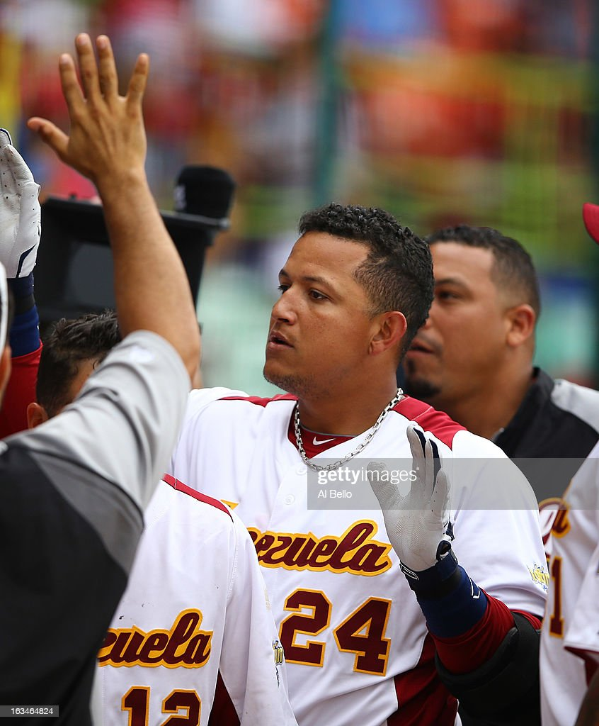 <a gi-track='captionPersonalityLinkClicked' href=/galleries/search?phrase=Miguel+Cabrera&family=editorial&specificpeople=202141 ng-click='$event.stopPropagation()'>Miguel Cabrera</a> #24 of Venezuela celebrates with teamates after hitting a home run against Spain during the first round of the World Baseball Classic at Hiram Bithorn Stadium on March 10, 2013 in San Juan, Puerto Rico.