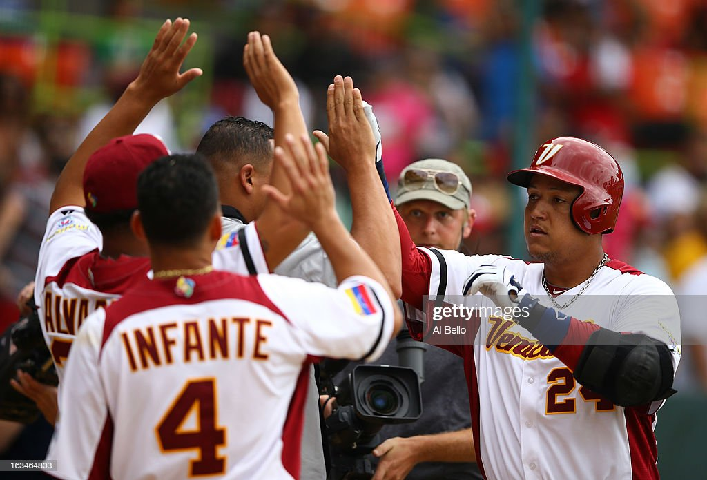 <a gi-track='captionPersonalityLinkClicked' href=/galleries/search?phrase=Miguel+Cabrera&family=editorial&specificpeople=202141 ng-click='$event.stopPropagation()'>Miguel Cabrera</a> #24 of Venezuela celebrates withteamates after hitting a home run against Spain during the first round of the World Baseball Classic at Hiram Bithorn Stadium on March 10, 2013 in San Juan, Puerto Rico.