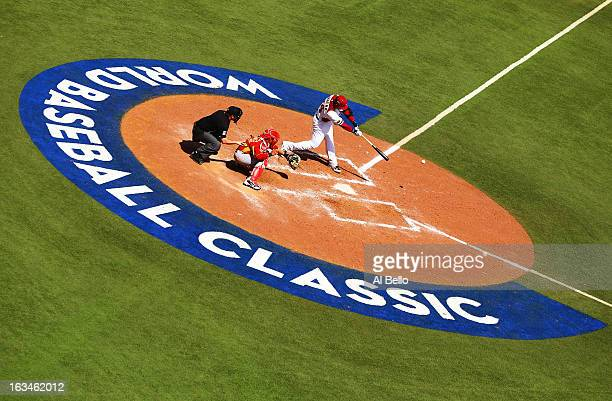 Miguel Cabrera of Venezuela gets a hit and drives in a run against Spain during the first round of the World Baseball Classic at Hiram Bithorn...