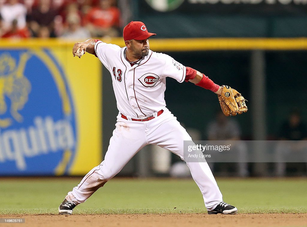 <a gi-track='captionPersonalityLinkClicked' href=/galleries/search?phrase=Miguel+Cairo&family=editorial&specificpeople=162685 ng-click='$event.stopPropagation()'>Miguel Cairo</a> #43 of the Cincinnati Reds throws the ball to first base during the game against the Pittsburgh Pirates at Great American Ball Park on August 4, 2012 in Cincinnati, Ohio.