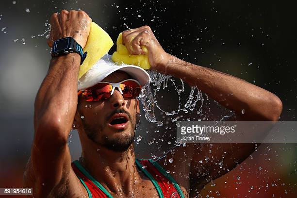 Miguel Carvalho of Portugal cools off with water during the Men's 50km Race Walk on Day 14 of the Rio 2016 Olympic Games at Pontal on August 19 2016...