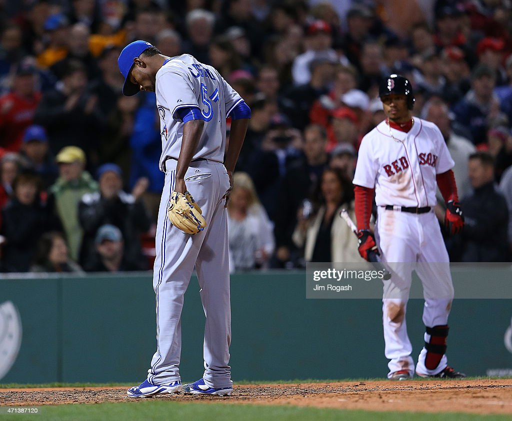 Miguel Castro #51 of the Toronto Blue Jays reacts after throwing a wild pitch, allowing runner to advance in the ninth inning at Fenway Park April 27, 2015 in Boston, Massachusetts.