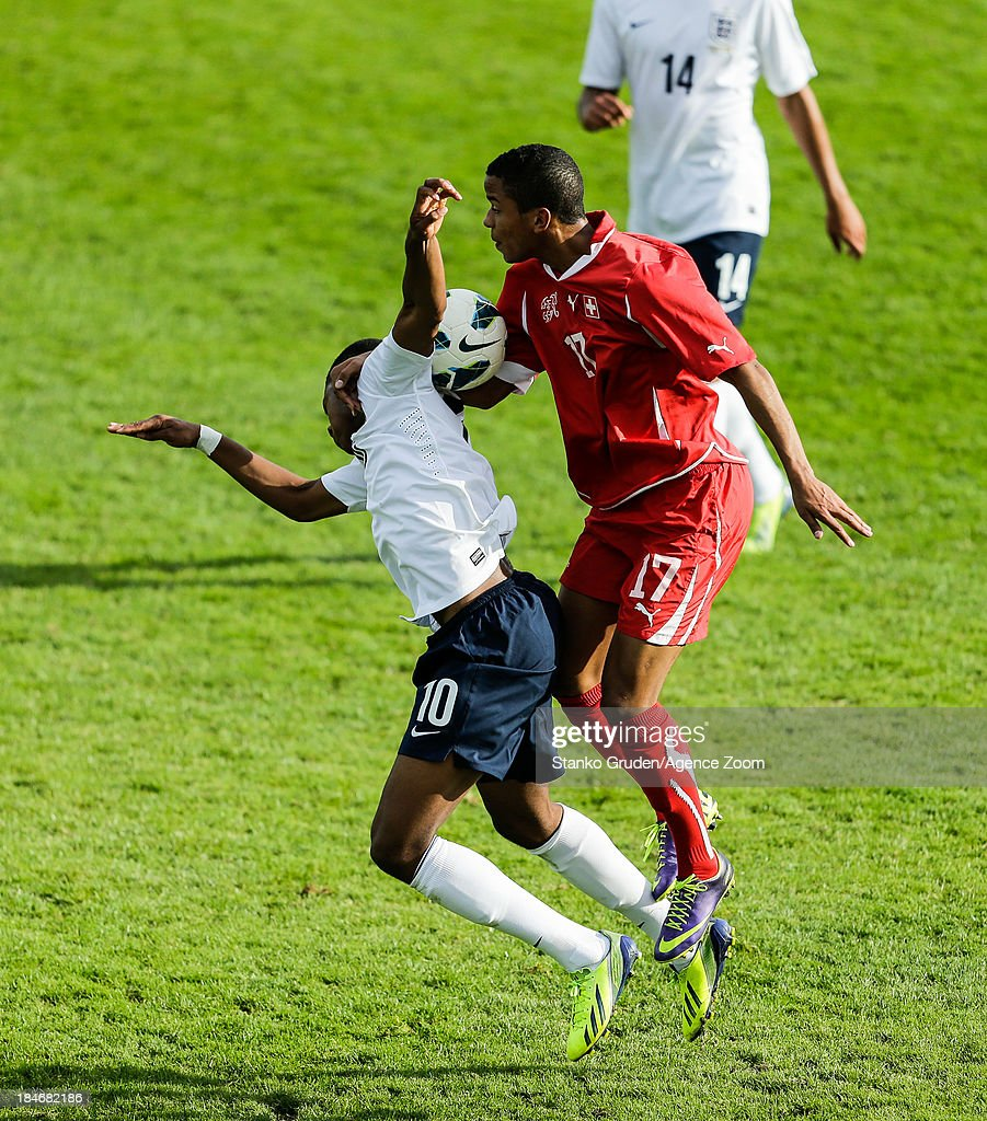 Miguel Castroman of Switzerland and Chuba Akpom of England in action during the UEFA U19 Championships Qualifier between England and Switzerland, on October 15, 2013 in Ptuj, Slovenia.
