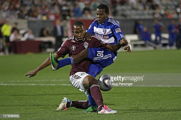 Miguel Comminges of the Colorado Rapids blocks a shot by Marvin Chavez of the FC Dallas at Dick's Sporting Goods Park on October 1 2011 in Commerce...