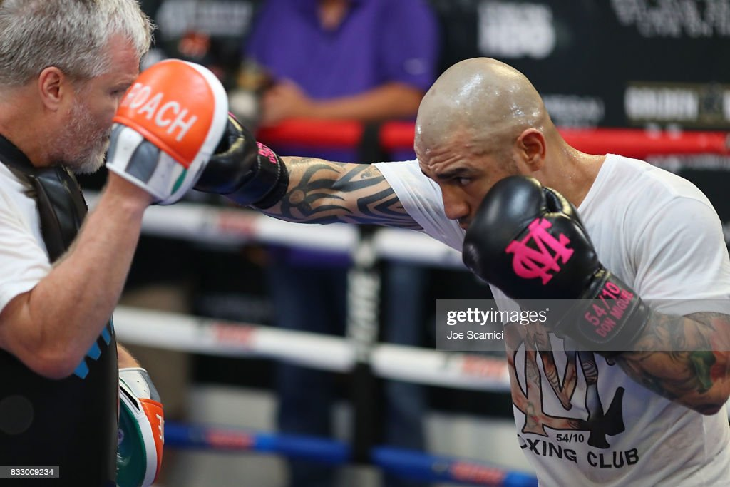 Miguel Cotto and Freddie Roach train during a media workout on August 16, 2017 in Los Angeles, California.