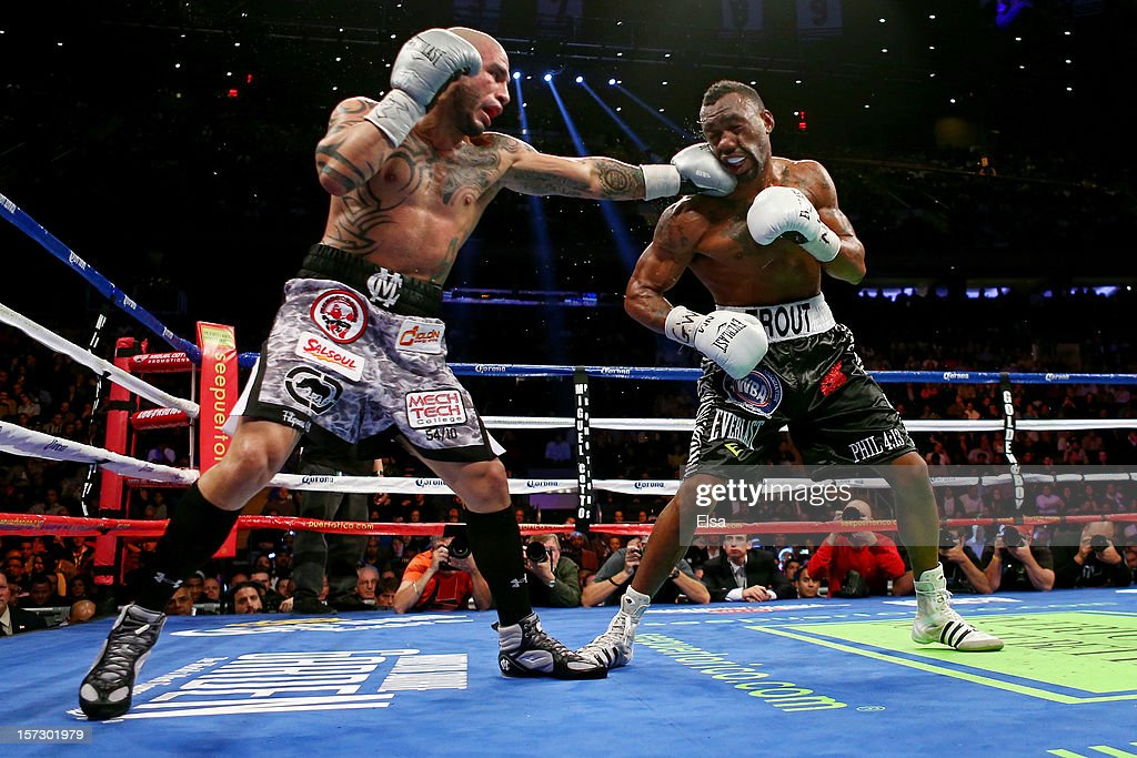 <a gi-track='captionPersonalityLinkClicked' href=/galleries/search?phrase=Miguel+Cotto&family=editorial&specificpeople=4329258 ng-click='$event.stopPropagation()'>Miguel Cotto</a> (L) connects on a punch while fighting against Austin Trout in their WBA Super Welterweight Championship title fight at Madison Square Garden on December 1, 2012 in New York City.