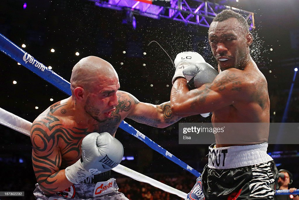 <a gi-track='captionPersonalityLinkClicked' href=/galleries/search?phrase=Miguel+Cotto&family=editorial&specificpeople=4329258 ng-click='$event.stopPropagation()'>Miguel Cotto</a> (L) connects on a punch while fighting against <a gi-track='captionPersonalityLinkClicked' href=/galleries/search?phrase=Austin+Trout&family=editorial&specificpeople=3078881 ng-click='$event.stopPropagation()'>Austin Trout</a> in their WBA Super Welterweight Championship title fight at Madison Square Garden on December 1, 2012 in New York City.