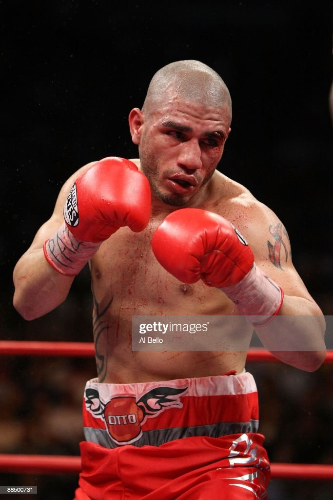 Miguel Cotto fights with a cut after an accidental head butt by Joshua Clottey during their WBO Welterweight title fight at Madison Square Garden on...