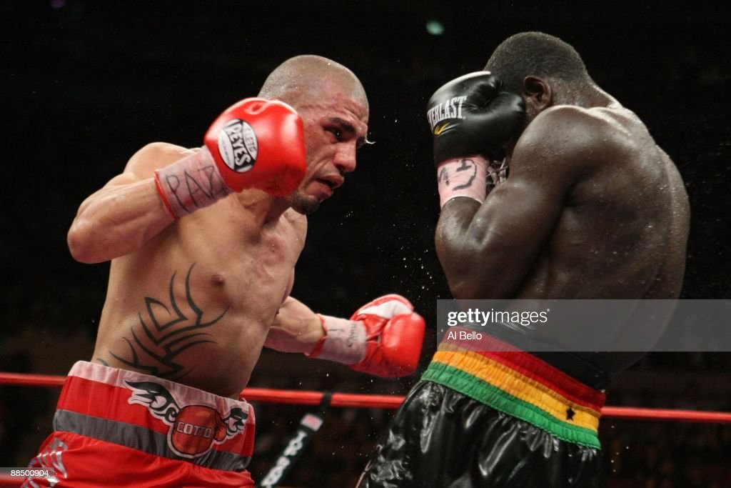 Miguel Cotto punches Joshua Clottey during their WBO Welterweight title fight at Madison Square Garden on June 13 2009 in New York New York