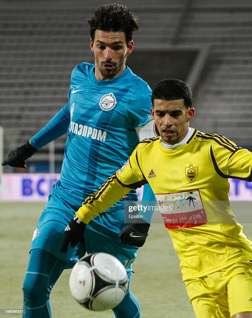 Miguel Danny of FC Zenit St. Petersburg (L) and Mbark Boussoufa of FC Anzhi Makhachkala vie for the ball during the Russian Premier League match between FC Zenit St. Petersburg and FC Anzhi Makhachkala at the Petrovsky Stadium on December 10, 2012 in St. Petersburg, Russia.