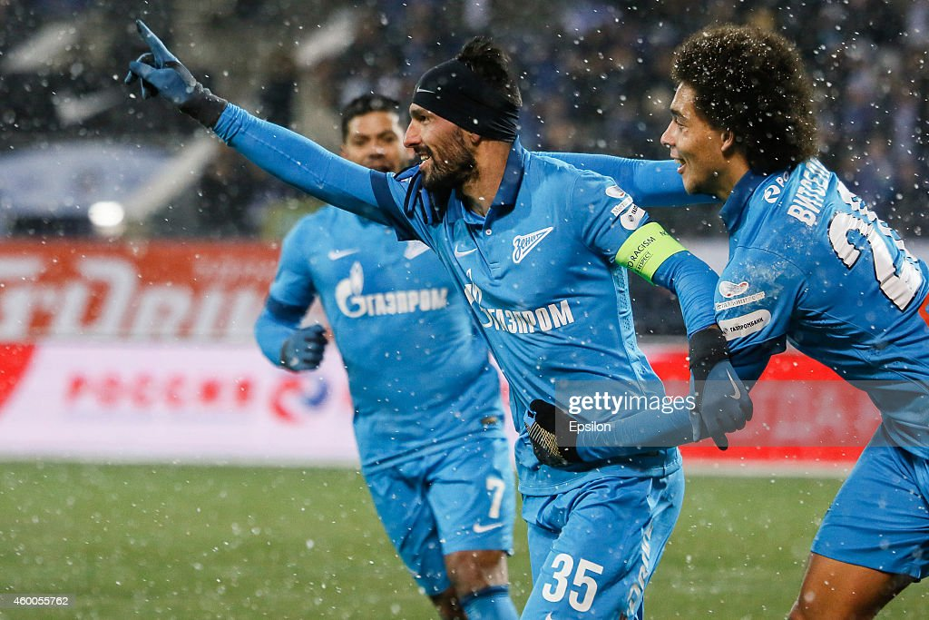 Miguel Danny of FC Zenit St. Petersburg (C) celebrates his goal with Hulk of FC Zenit St. Petersburg (L) and Axel Witsel of FC Zenit St. Petersburg during the Russian Football League Championship match between FC Zenit St. Petersburg and FC Krasnodar at the Petrovsky stadium on December 6, 2014 in St. Petersburg, Russia.