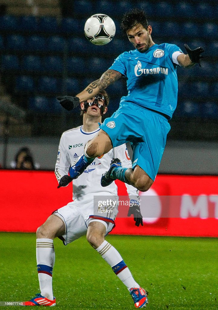 Miguel Danny of FC Zenit St. Petersburg (R) heads the ball as Mario Fernandes of PFC CSKA Moscow defends during the Russian Football League Championship match between FC Zenit St. Petersburg and PFC CSKA Moscow at the Petrovsky Stadium on November 26, 2012 in St. Petersburg, Russia.