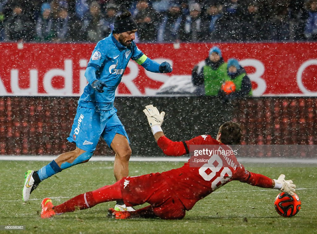 Miguel Danny of FC Zenit St. Petersburg (L) vies for the ball with Andrey Sinitsyn of FC Krasnodar during the Russian Football League Championship match between FC Zenit St. Petersburg and FC Krasnodar at the Petrovsky stadium on December 6, 2014 in St. Petersburg, Russia.