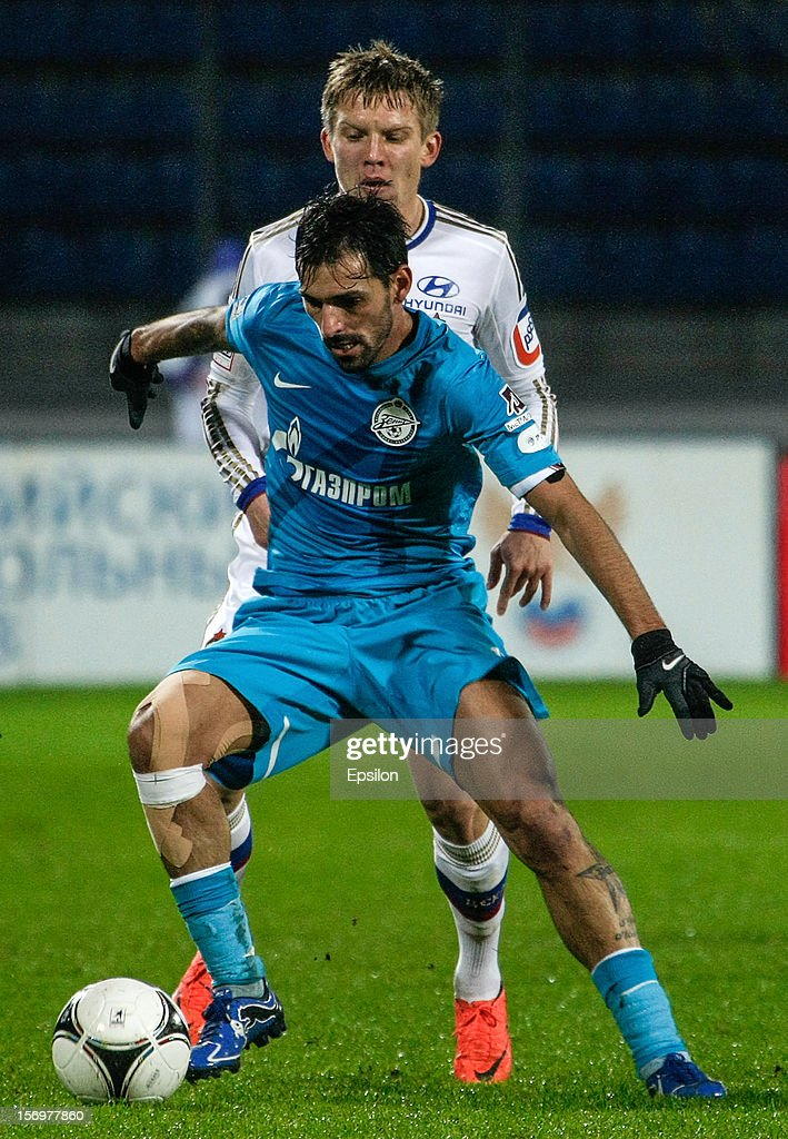 Miguel Danny of FC Zenit St. Petersburg (in front) vies for the ball with Aleksandrs Cauna of PFC CSKA Moscow during the Russian Football League Championship match between FC Zenit St. Petersburg and PFC CSKA Moscow at the Petrovsky Stadium on November 26, 2012 in St. Petersburg, Russia.