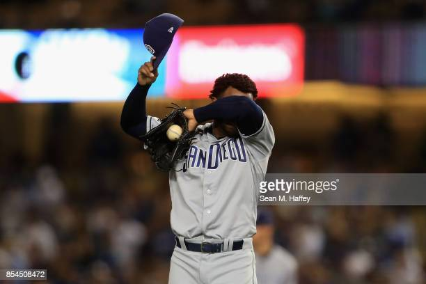 Miguel Diaz of the San Diego Padres reacts to giving up a threerun homerun to Corey Seager of the Los Angeles Dodgers during the seventh inning of a...