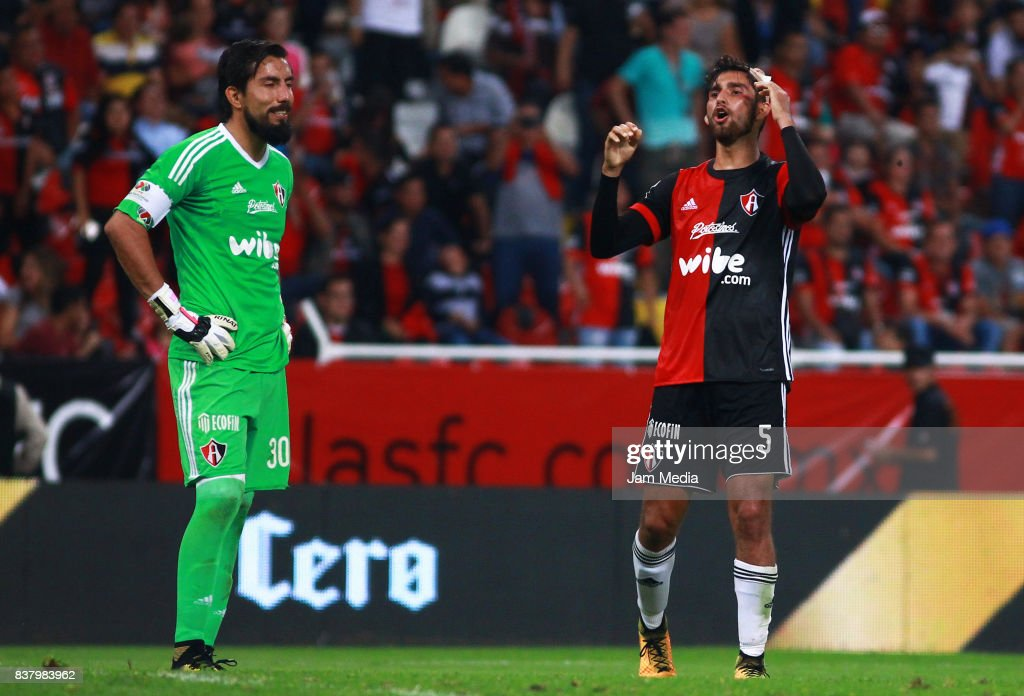 Miguel Fraga (L) goalkeeper and Gaddi Aguirre (R) of Atlas react during the 6th round match between Atlas and Lobos BUAP as part of the Torneo Apertura 2017 Liga MX at Jalisco Stadium on August 22, 2017 in Guadalajara, Mexico.