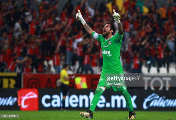 Miguel Fraga of Atlas celebrates his team's goal scored by Daniel Arreola during the 6th round match between Atlas and Lobos BUAP as part of the...