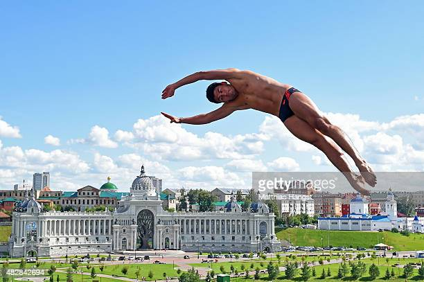 Miguel Garcia of Colombia competes in the Men's High Diving 27m preliminary round on day ten of the 16th FINA World Championships at the Kazanka...
