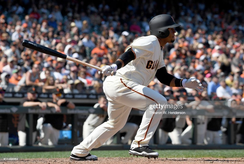 Miguel Gomez #52 of the San Francisco Giants hits an rbi single scoring Brandon Crawford #35 against the Miami Marlins in the bottom of the eighth inning at AT&T Park on July 9, 2017 in San Francisco, California. The hit and rbi was the first of Gomez's career.