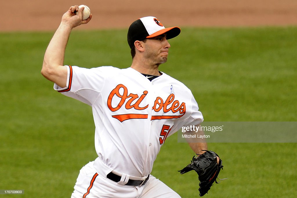 Miguel Gonzalez #50 of the Baltimore Orioles pitches during a baseball game against the Boston Red Sox on June 16, 2013 at Oriole Park at Camden Yards in Baltimore, Maryland.