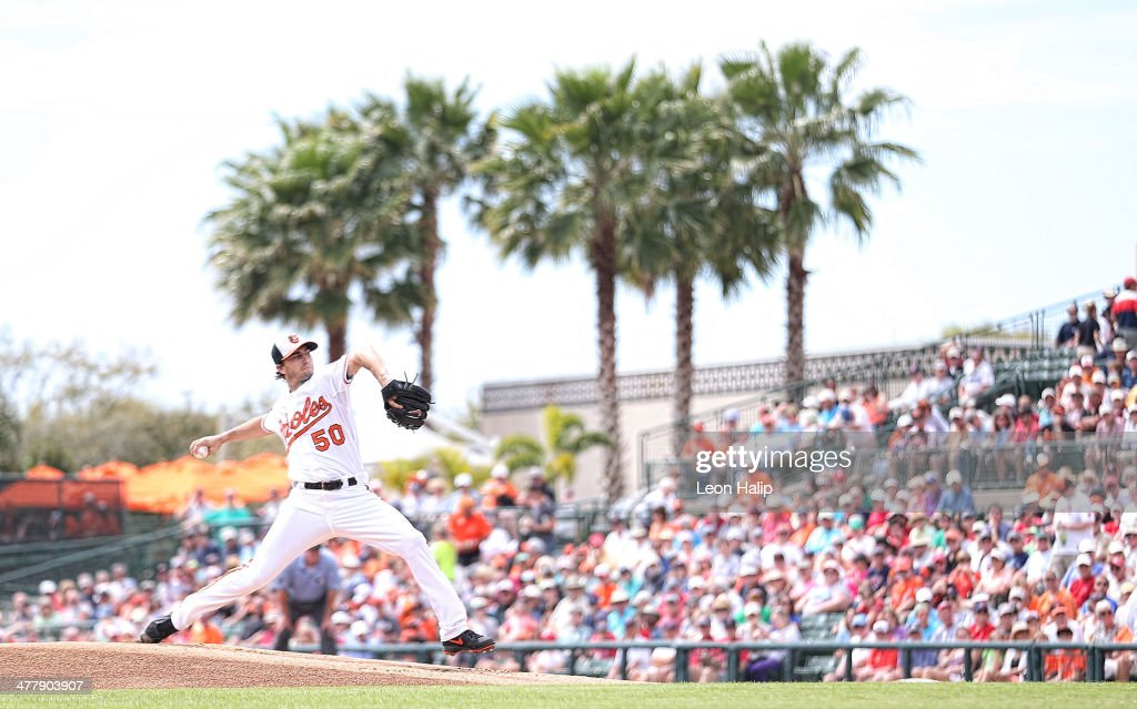 Miguel Gonzalez of the Baltimore Orioles pitches in the first inning of the spring training game against the Boston Red Sox at Ed Smith Stadium on...