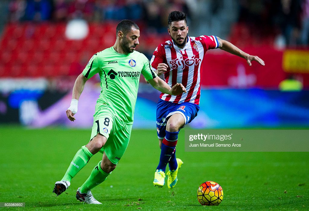 Miguel Guerrero of Real Sporting de Gijon duels for the ball with Mehdi Lacen of Getafe CF during the La Liga match between Real Sporting de Gijon and Getafe CF at Estadio El Molinon on January 4, 2016 in Gijon, Spain.