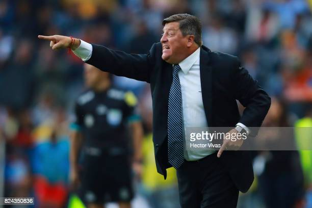 Miguel Herrera Coach of America gives instructions to his players during the 2nd round match between Pachuca and America as part of the Torneo...