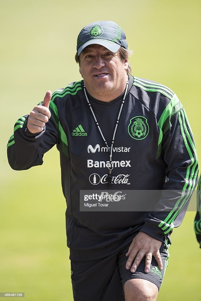 Miguel Herrera coach of Mexican National soccer team greets during a training session at CAR on January 27, 2014 in Mexico City, Mexico. The team is preparing to face Korea in a friendly match before the FIFA World Cup in Brazil.