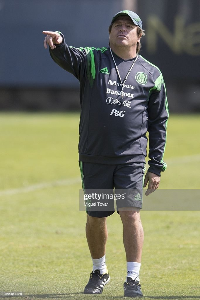 Miguel Herrera coach of Mexican National soccer team points during a training session at CAR on January 27, 2014 in Mexico City, Mexico. The team is preparing to face Korea in a friendly match before the FIFA World Cup in Brazil.
