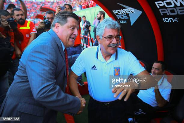 Miguel Herrera head coach of Tijuana greets Ricardo Ferretti head coach of Tigres during the semi final second leg match between Tijuana and Tigres...