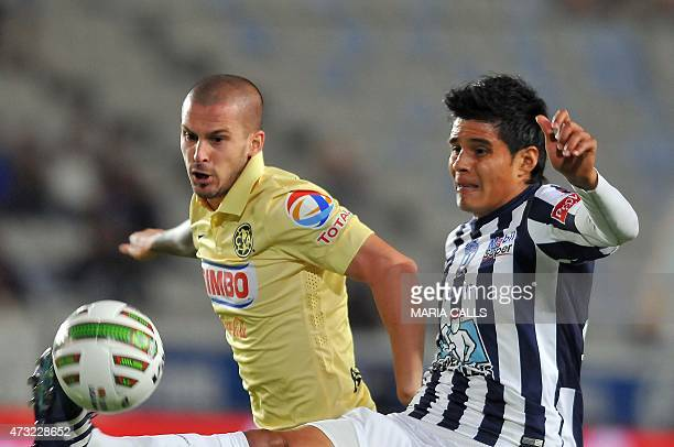 Miguel Herrera of Pachuca vies for the ball with Dario Benedetto of America during their 2015 Mexican Clausura tournament first leg quarterfinal...