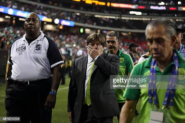 Miguel Herrera the head coach / manager of Mexico leaves the field at the end of the CONCACAF Gold Cup 2015 Semi Final between Panama and Mexico at...