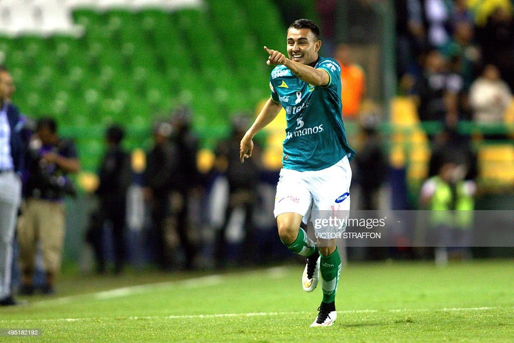 Miguel Ibarra of Leon celebrates his goal during their Mexican Apertura tournament football match against Atlas at the Nou Camp stadium on October 31...