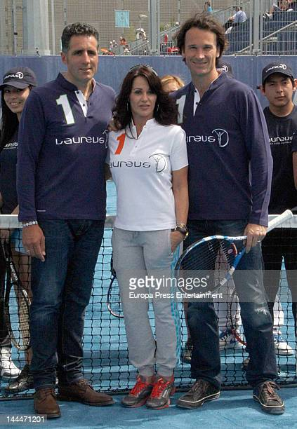 Miguel Indurain Nadia Comaneci and Carlos Moya attend the Mutua Madrilena Madrid Open on May 11 2012 in Madrid Spain